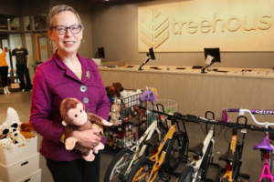 woman next to bikes at treehouse